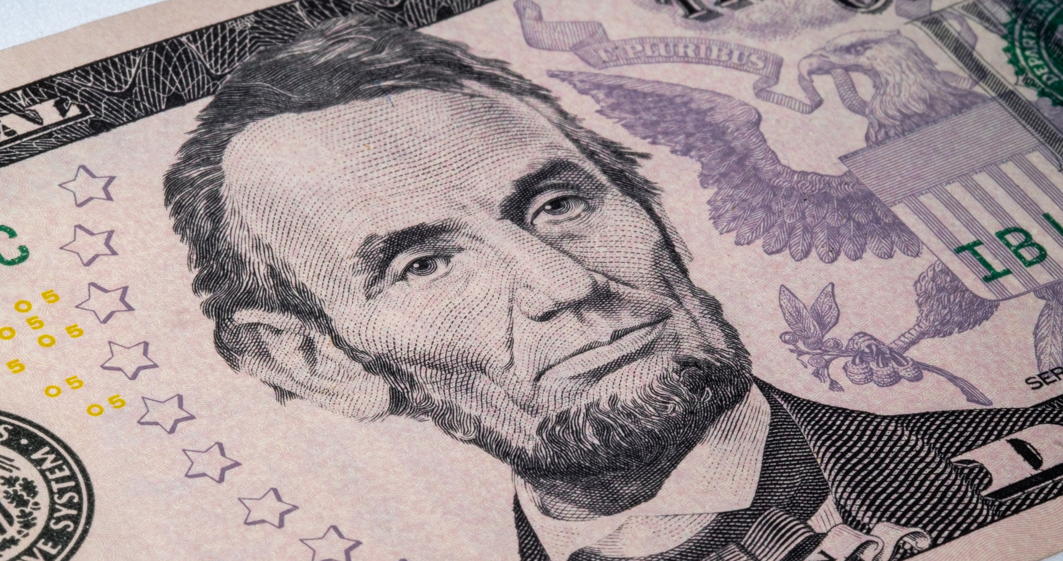Close-up of Abraham Lincoln on the five-dollar bill